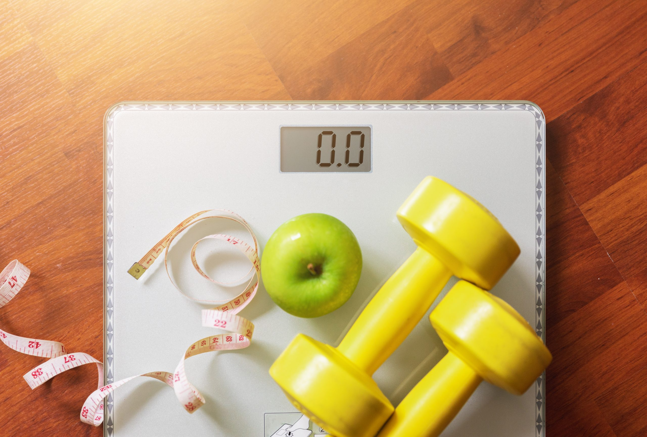 fruit, dumbbell and scale, fat burn and weight loss concept, diet